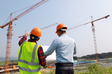 Builder workers looking at new construction plan